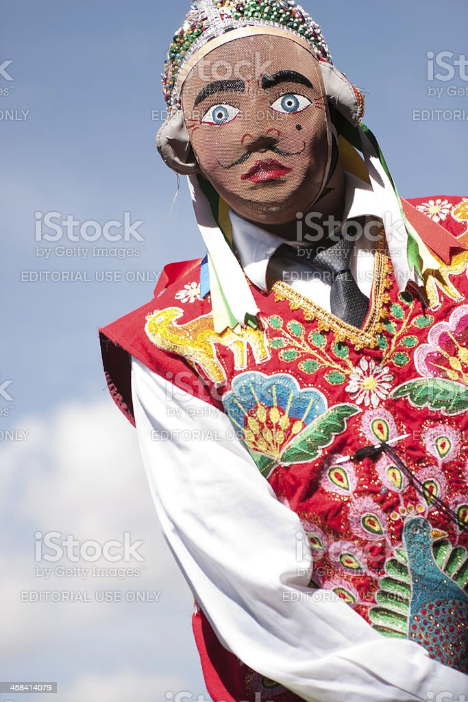 Masked Man Dancing during Cusco Parade stock photo