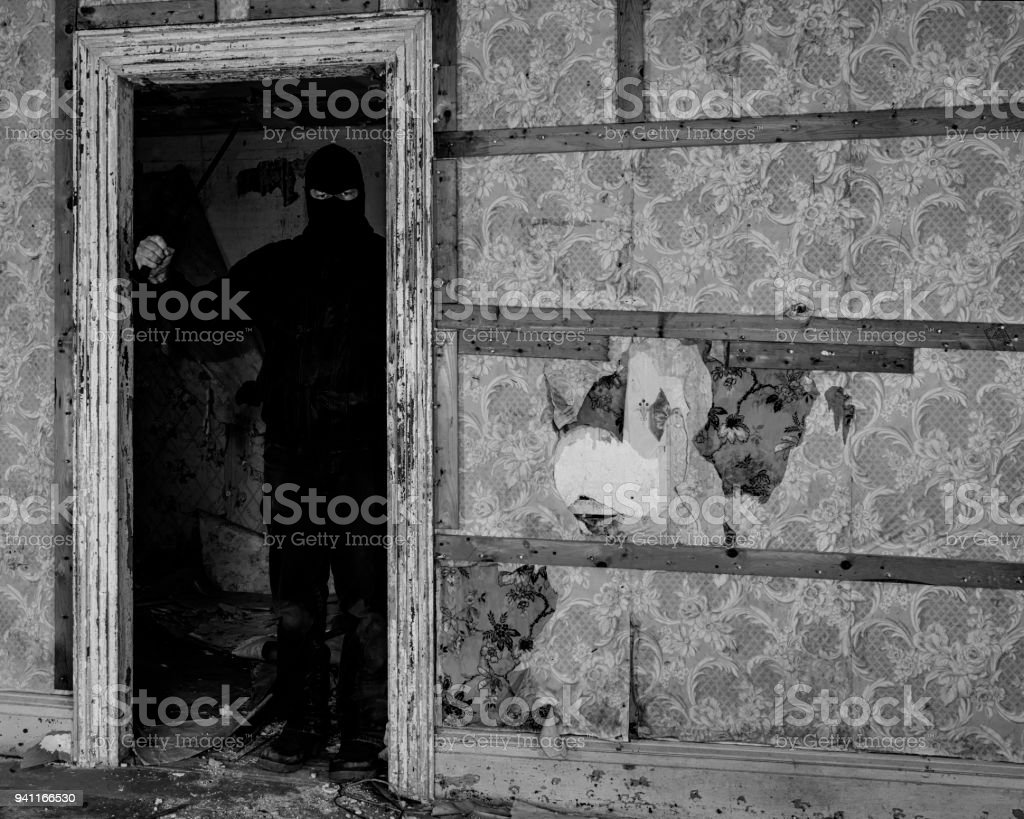 Masked Man In An Abandoned Building Stock Photo Download Image Now Istock