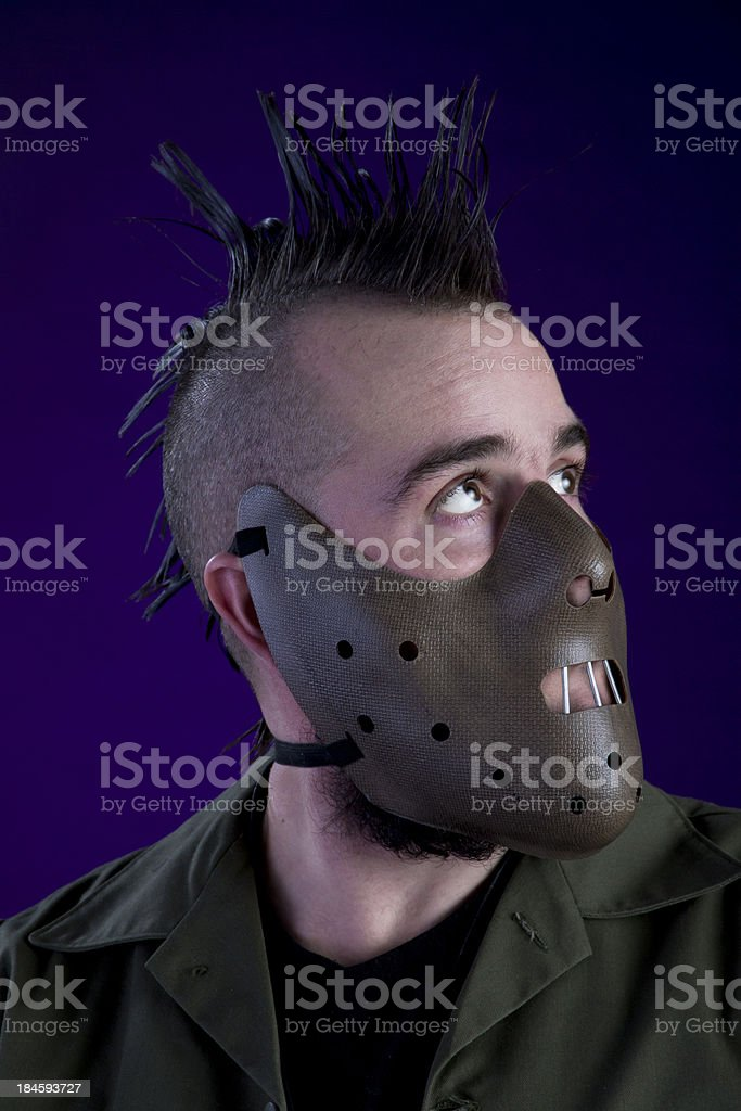 Masked Man Looking to the Heavens stock photo