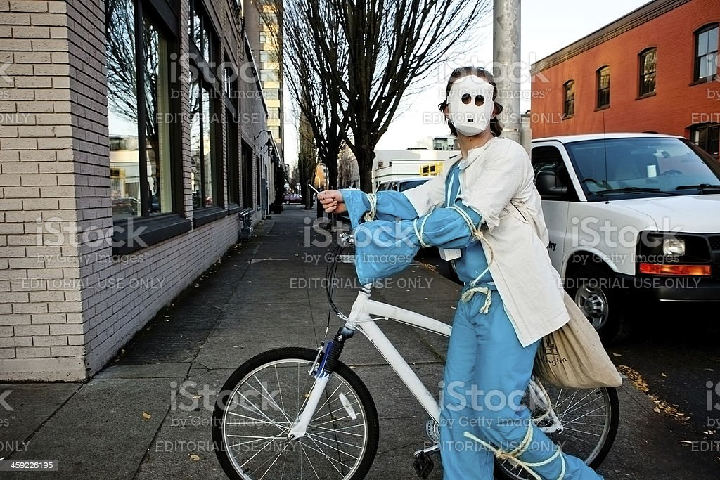 Masked man with a bike stock photo