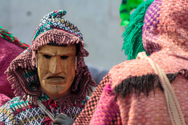 masked men at iberian mask festival parade in lisbon - demoniac stock pictures, royalty-free photos & images
