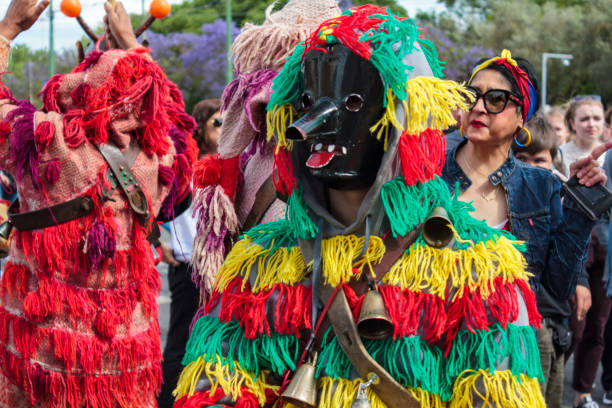 masked men (caretos) at iberian mask festival parade in lisbon - demoniac stock pictures, royalty-free photos & images