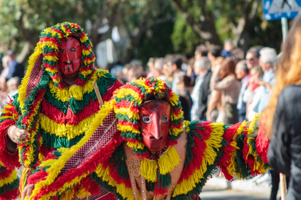 masked men (caretos de podence) at iberian mask international festival in lisbon - demoniac stock pictures, royalty-free photos & images
