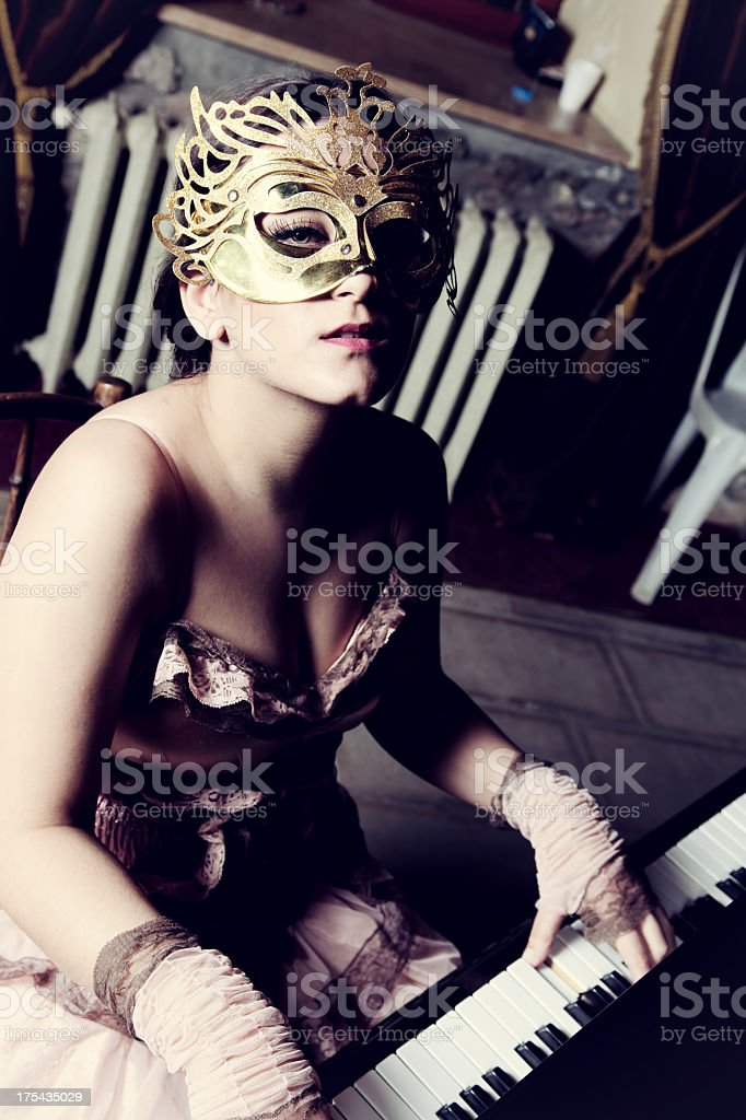 Masked piano player royalty-free stock photo