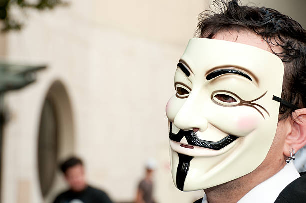 masked protester - guy fawkes mask stock photos and pictures