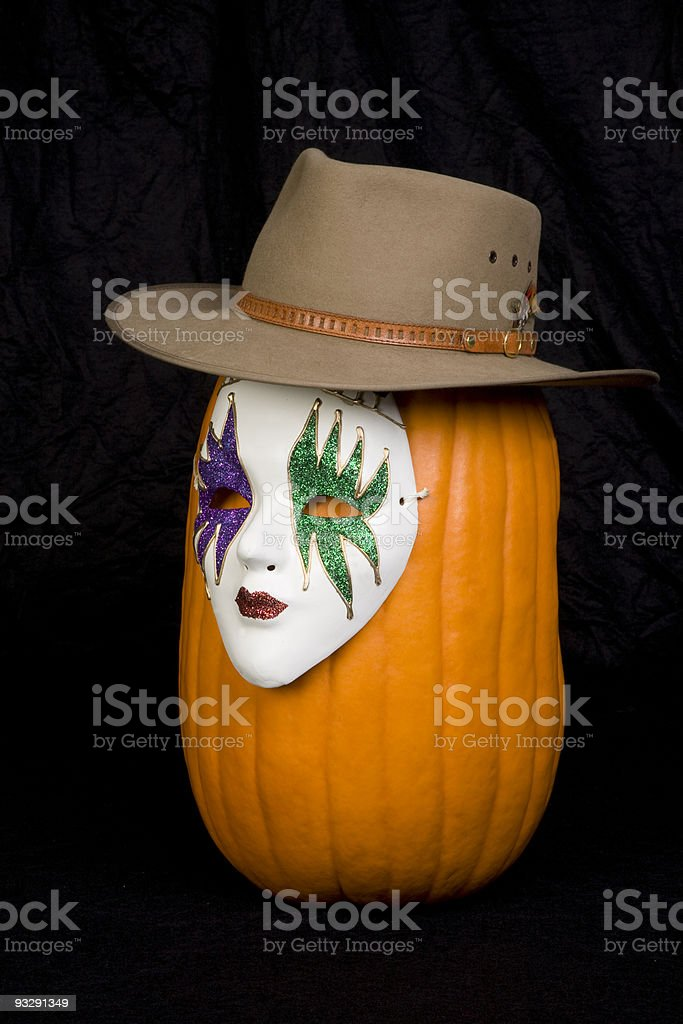 Masked Pumpkin Wearing a Hat royalty-free stock photo