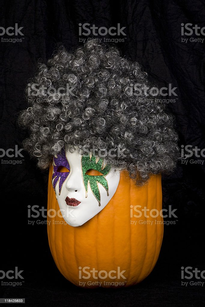 Masked Pumpkin Wearing a Wig stock photo