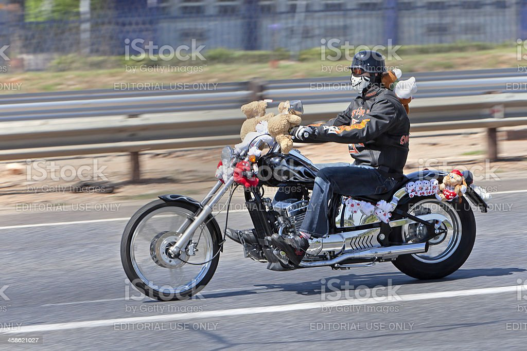 Masked Rider travelling to the Toy Run royalty-free stock photo