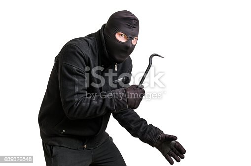 istock Masked thief in balaclava with crowbar isolated on white 639326548