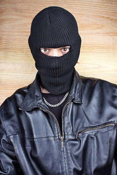 Masked thief stock photo