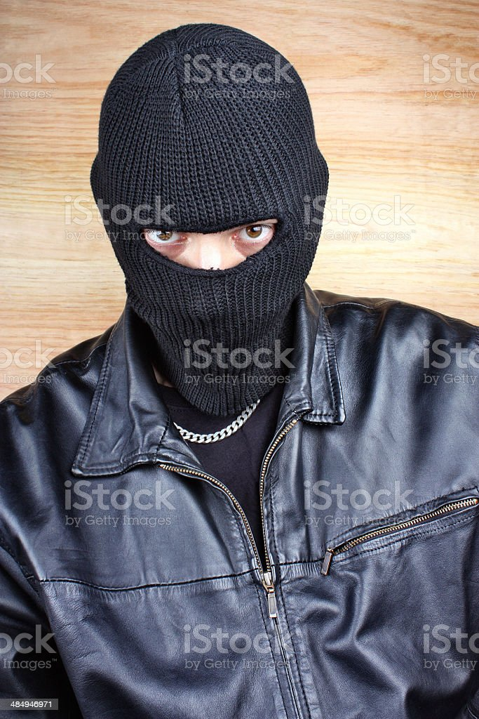 Masked thief stock photo