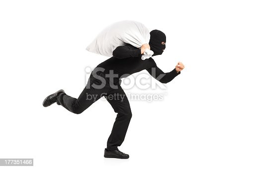 istock Masked thief running away with his loot 177351466