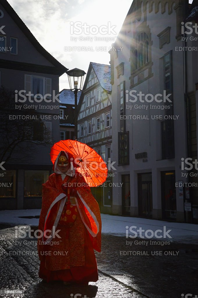 Masked woman dressed in Asian costume stock photo