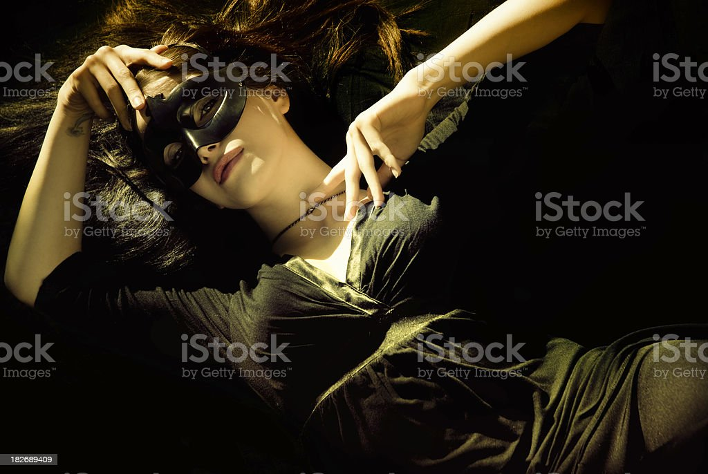 Masked woman in black stock photo