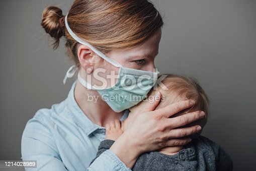 istock Masked Woman 1214028989