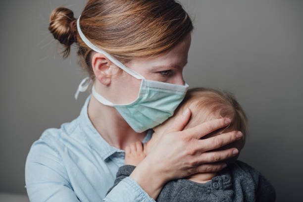 Masked Woman Nurse with Mask in Studio pandemic illness stock pictures, royalty-free photos & images