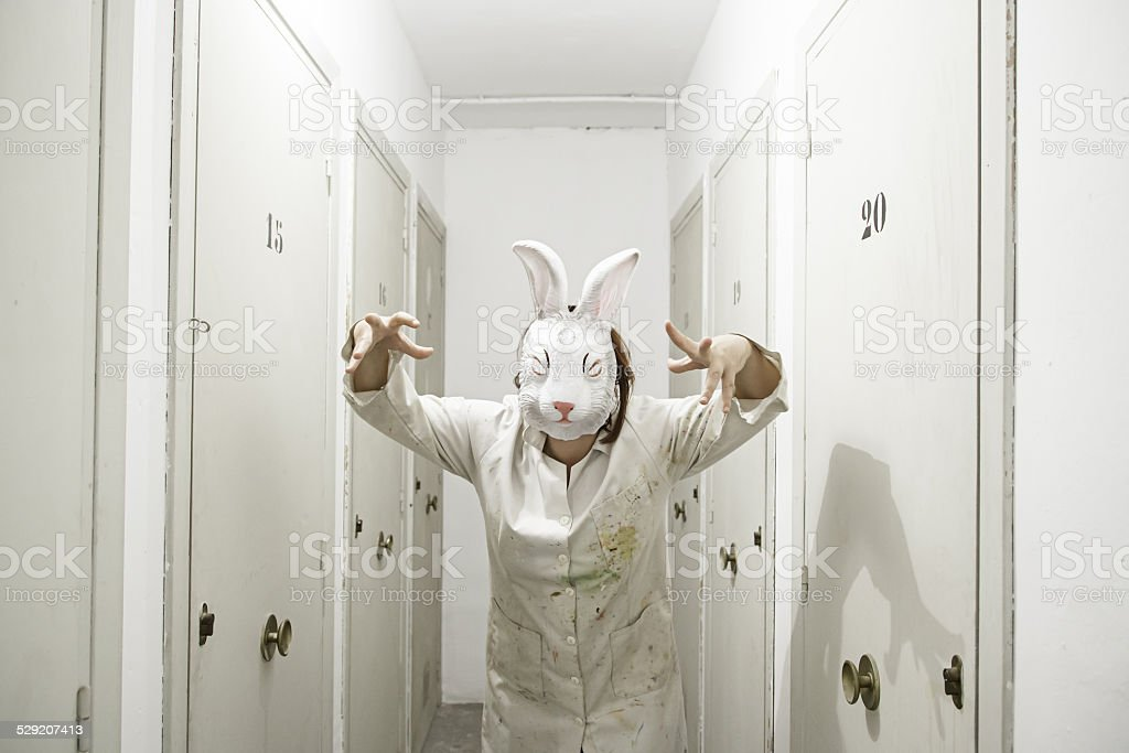 Masked woman rabbit stock photo