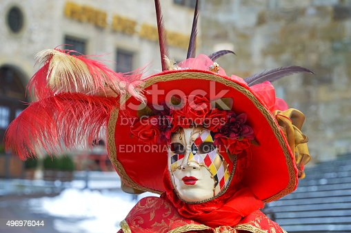 Schwabisch Hall, Germany - 08 February 2015: Portrait of a masked woman, which wears a hat decorated with colored feathers, participant at the