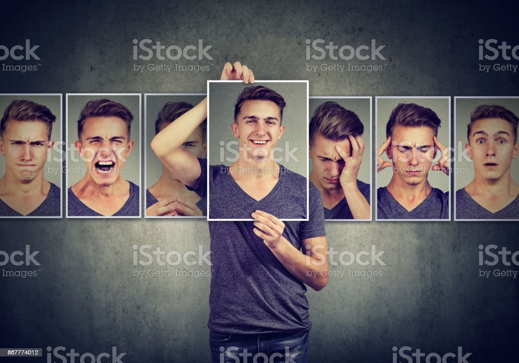 Masked young man expressing different emotions stock photo