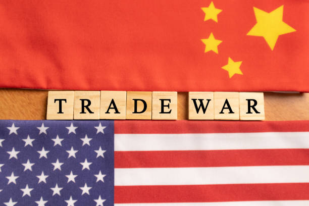 Maski, India 29,May 2019 : China-US trade war concept - flag of China and the United States with wooden block lettes Maski, India 29,May 2019 : China-US trade war concept - flag of China and the United States with wooden block lettes. trade war stock pictures, royalty-free photos & images