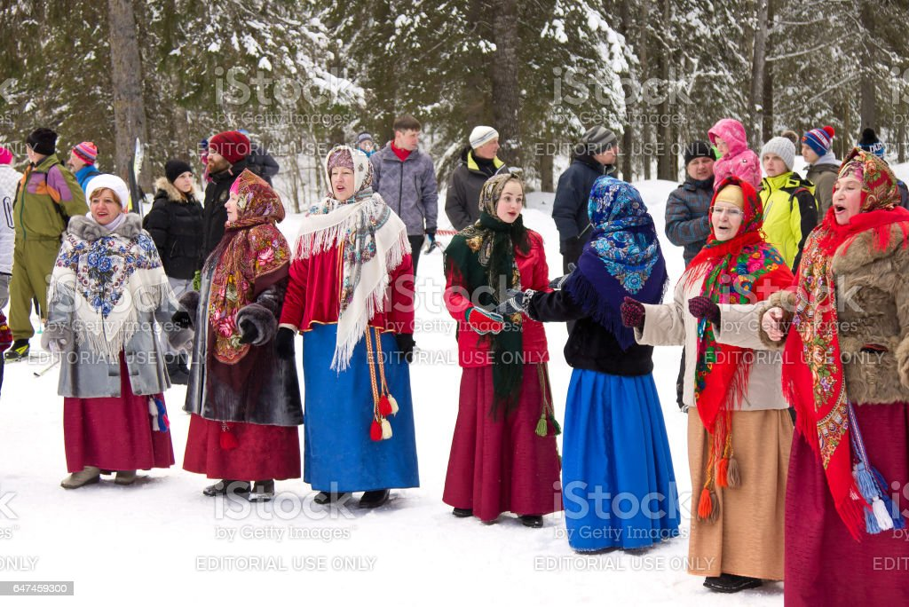 Maslenitsa - folk group participating at the spring coming festival stock photo