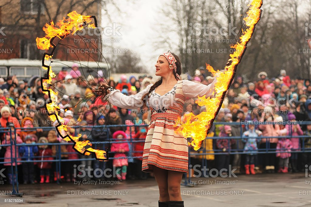 Maslenitsa, Pancake festival. Fire dancer in Russian clothes performing stock photo