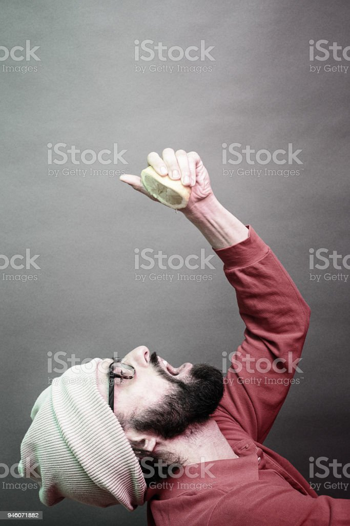 masochism with a lemon stock photo