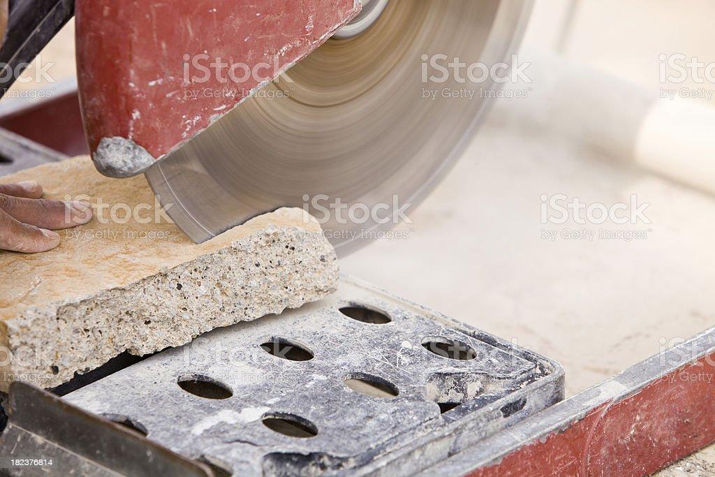 Mason Cutting a Stone with Dry Saw stock photo