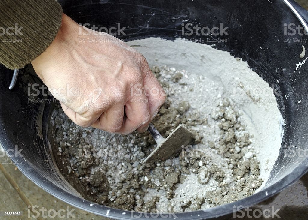 Mason Hand Preparing Cement royalty-free stock photo
