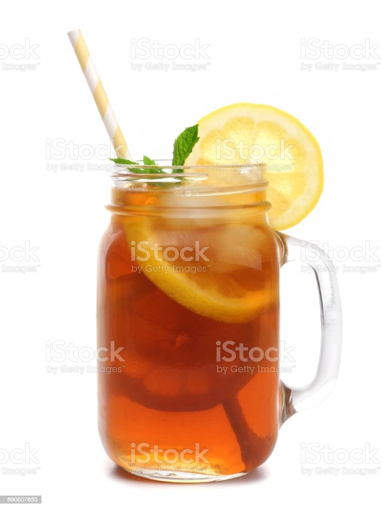 Mason jar glass of iced tea with straw isolated on white - Photo