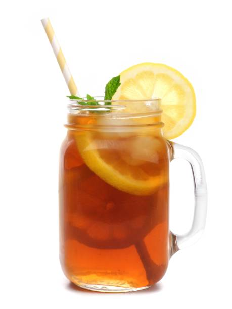 mason jar glass of iced tea with straw isolated on white - gefrorenes obst tassen stock-fotos und bilder