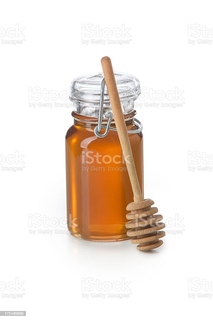 Mason Jar of Pure Honey with Dipper royalty-free stock photo