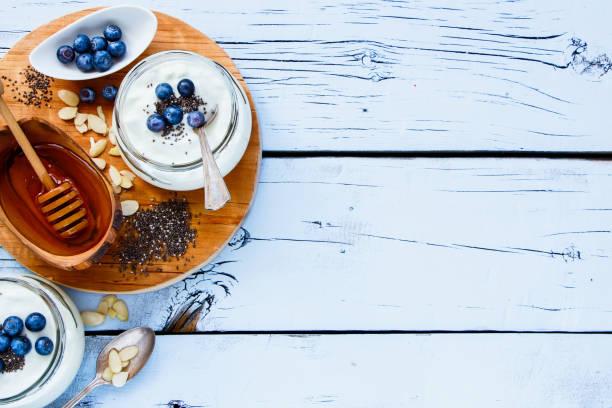 Mason jars of yogurt stock photo