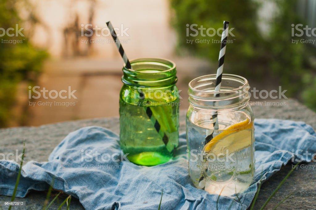 Mason jars with lemonade and hispter straws sunny day royalty-free stock photo