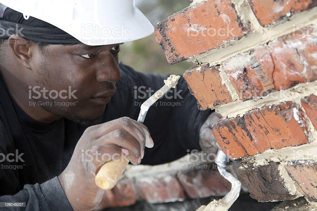 Mason points brick joint. stock photo