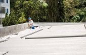 istock Mason worker repairing rooftop leakage 1277562989