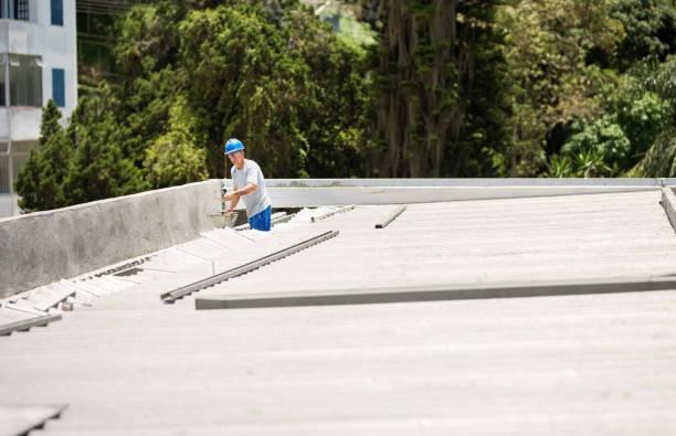 Mason worker repairing rooftop leakage stock photo