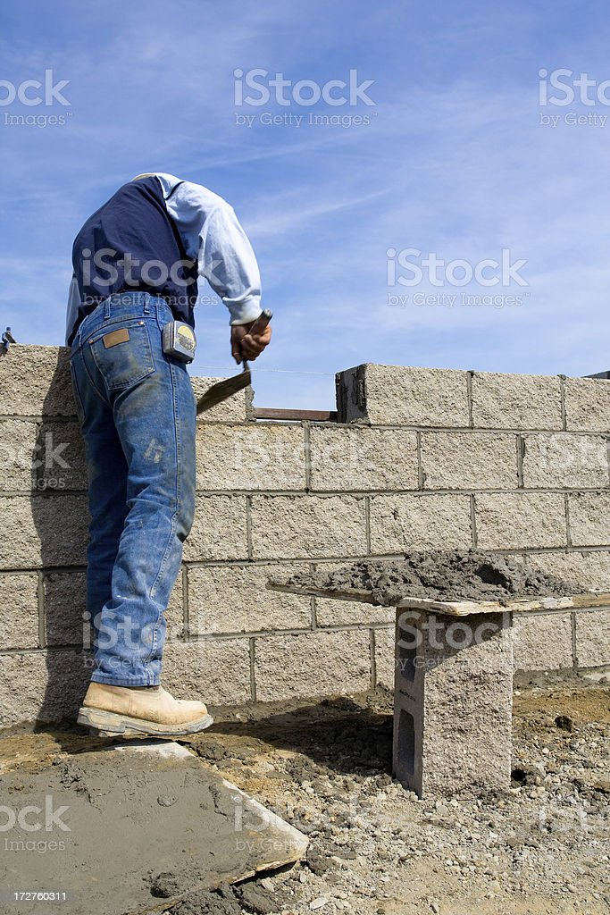 Mason working on wall stock photo