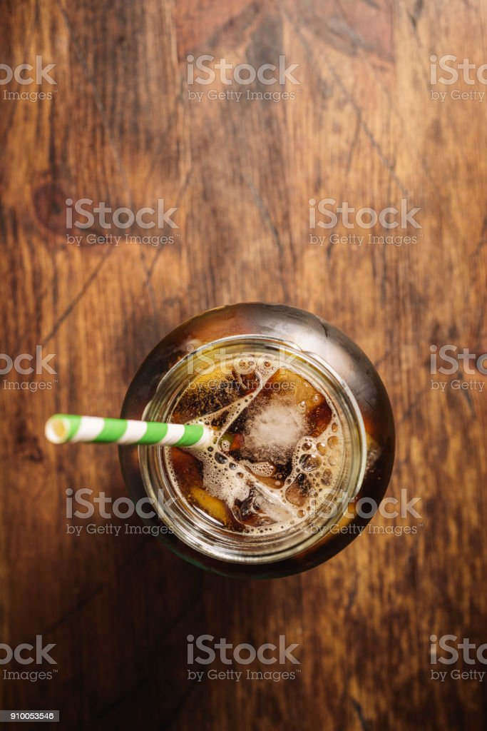 Masonry jar filled with iced cold brew coffee. stock photo