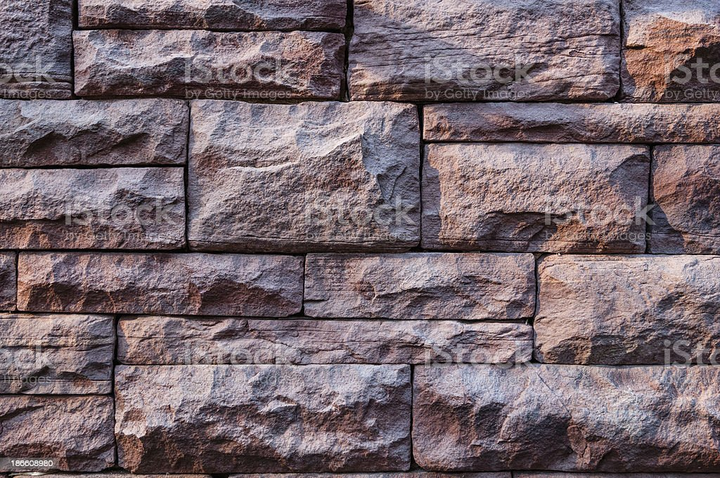 Masonry of red sandstone, as a wallpaper royalty-free stock photo