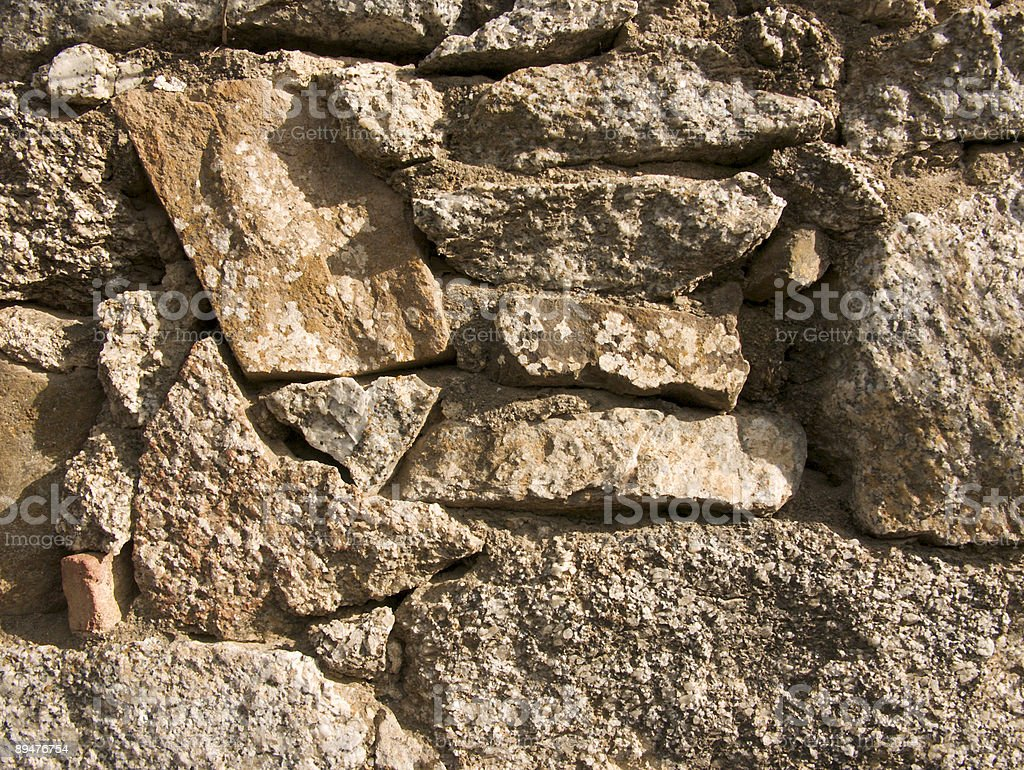 masonry stone wall stock photo