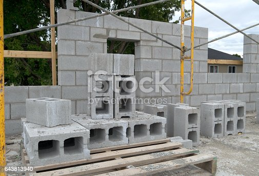 View of a cinder block masonry wall under constuction duing the building of a new residential apartment building