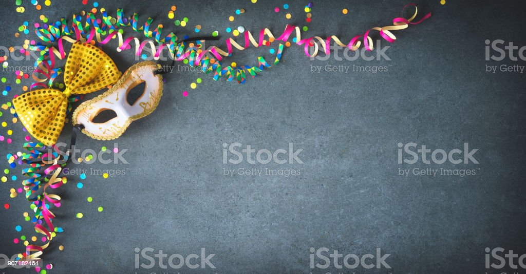 Masquerade decorations with streamers and confetti stock photo
