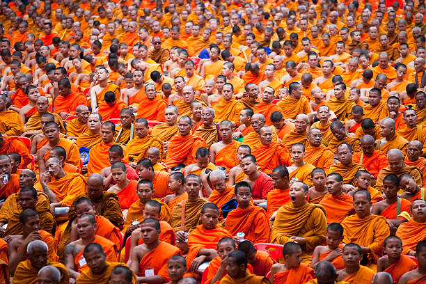 mass alms giving in bangkok - makha bucha stock photos and pictures