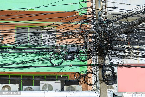 Mass tangle communication wires on electric pole in Bangkok Thailand.