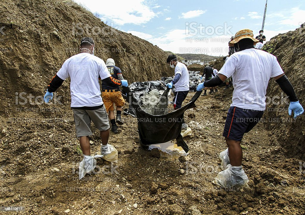 Mass grave in the Philippines stock photo