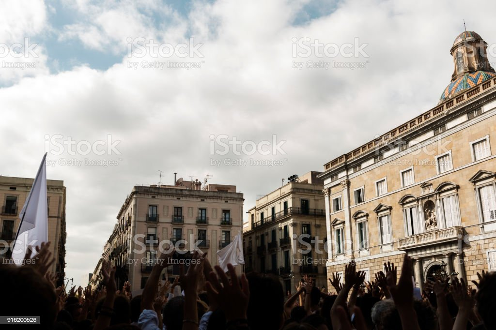 mass protest of people with raised hands and flags stock photo