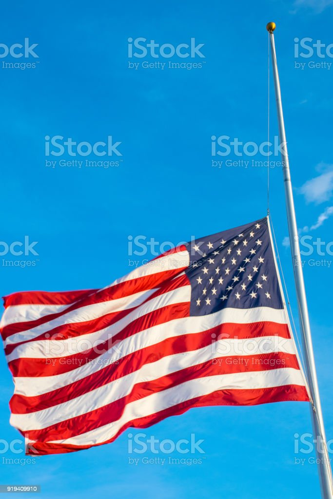 Mass Shooting brings down the American Flag at Half Mast after another School Shooting stock photo