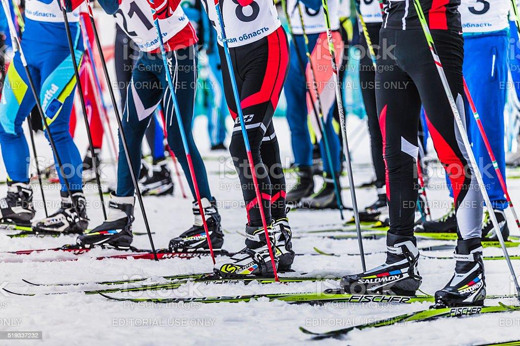 Mass start men athletes skiers stock photo