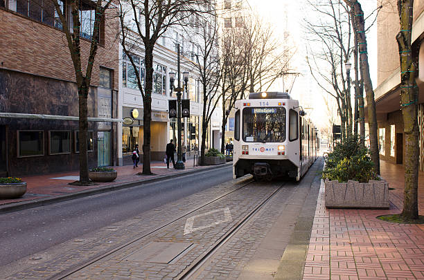 Mass transit train operates in downtown stock photo